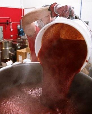 Redlaw pour sauce into vats